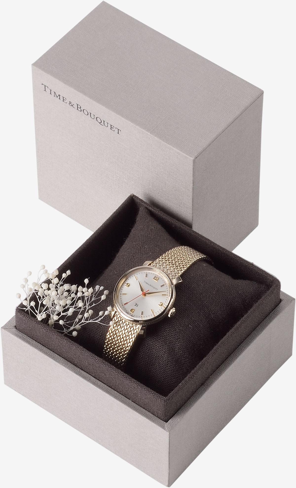 ハーフリネンの生地を内張りとクッションに使用した贅沢なギフトボックスに収納した腕時計コクリコ