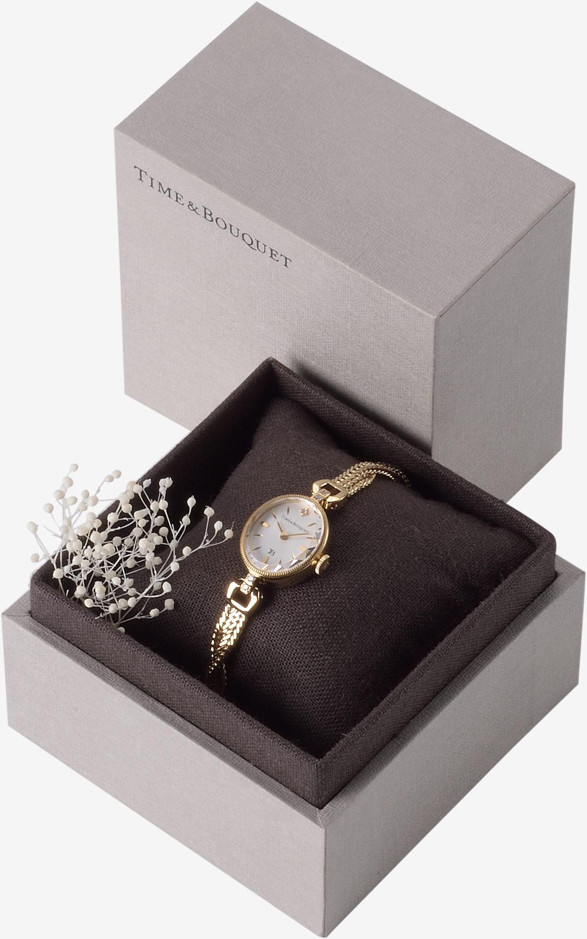 ハーフリネンの生地を内張りとクッションに使用した贅沢なギフトボックスに収納した腕時計ミュゲ